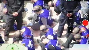 Şok edici dron görüntüleri, Xinjiang'daki bir topluma kampında erkeklerin gözlerinin bağlı ve zincirlenmiş olduklarını gösterdi.